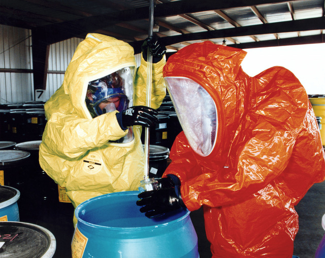 Yermo Annex. Dressed in Self Contained Toxic Environmental Protective Outfits (STEPO), personnel of the Hazardous Incident Response Team carefully take samples during training at the Hazardous Material Storage Area