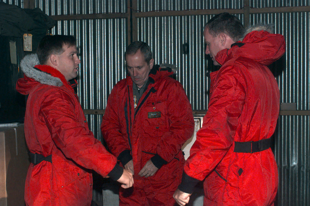 MGEN James Haight (center) the Mobilization Assistant to Commander 15th Air Force, Travis Air Force Base, California is fitted with bright orange extreme cold weather gear as other travelers to Antarctica stand by. MGEN Haight is to observe the Air Force's participation in the joint, U.S. Armed Forces and New Zealand Defense Force, military operation which provides logistic support to the U.S. National Science Foundation's Program on Antarctica