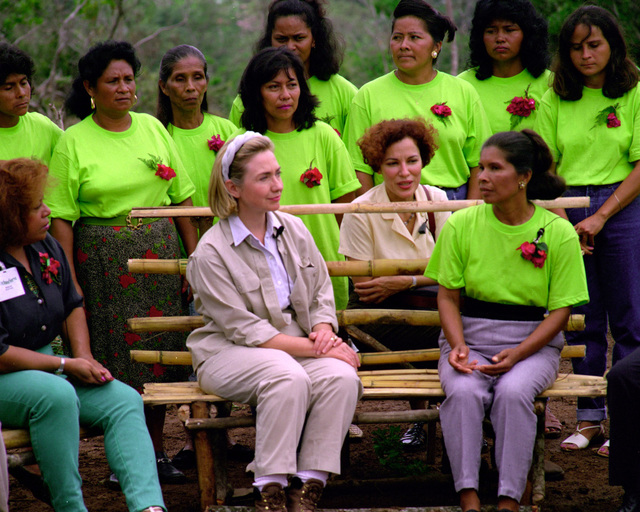 Mrs. Hillary Rodham-Clinton listens to the explanation of Faustina Hunez about the nursery in Chica
