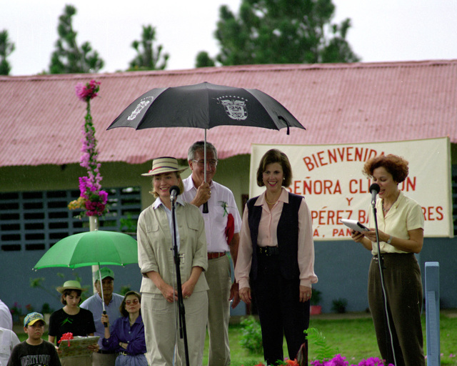 Mrs. Hillary Rodham-Clinton speaks to the local community before she returns to Howard Air Force Base. Directly behind Mrs. Clinton is Mr. William Huges, Ambassador of the United States, and Dora Boyd de Perez Balladares, the first Lady of Panama