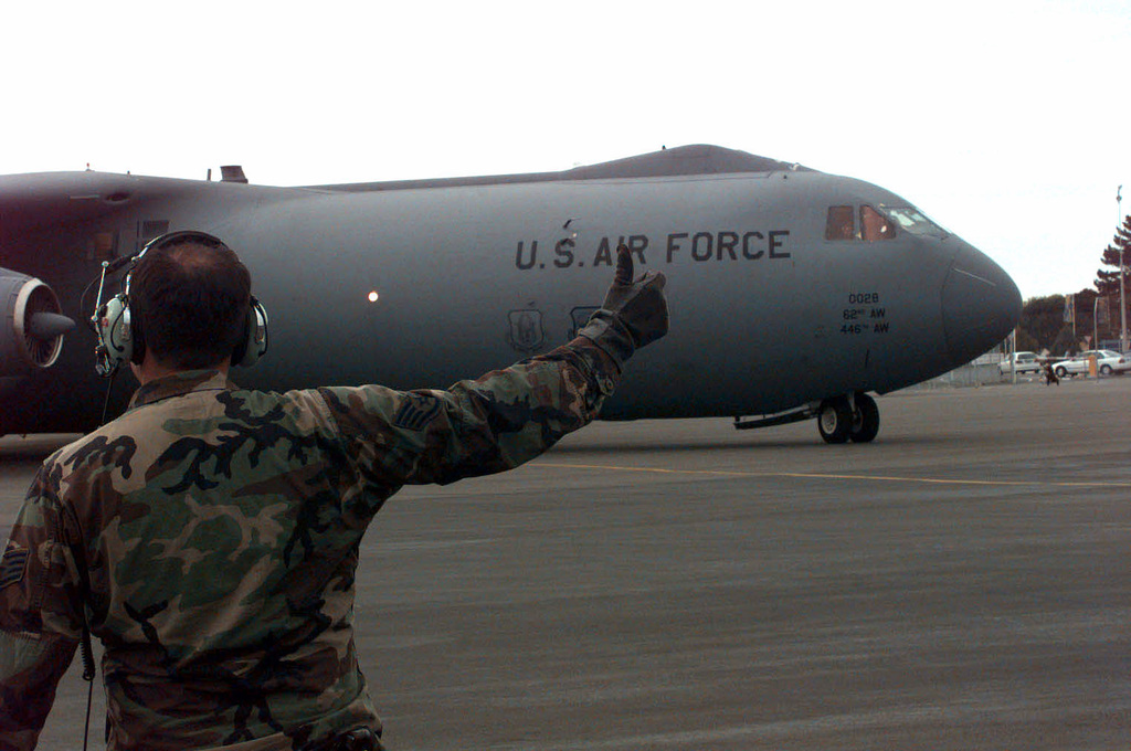 A ground crew member gives a thumbs-up to C-141B Starlifter, assigned to the 62nd Aircraft Generation Squadron, McChord Air Force Base, Washington, as it prepares to depart for McMurdo Base, Antarctica. The aircraft and personnel are participating in the joint, U.S. Armed Forces and New Zealand Defense Force, military operation which provides logistic support to the U.S. National Science Foundation's Program on Antarctica