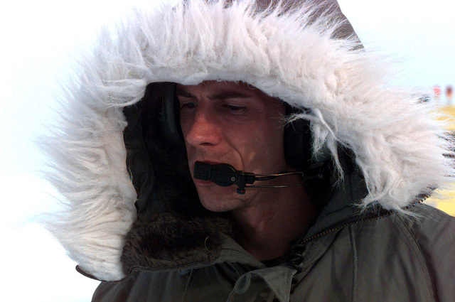 The face of flight engineer SSGT Silas R. Still, from the 8th Airlift Squadron (AS), McChord Air Force Base, Washington, is surrounded with a fur lined parka hood to protect him against the harsh Antarctic weather after his C-141B arrived at the base. The 8th AS men and equipment are participating in the joint, U.S. Armed Forces and New Zealand Defense Force, military operation which provides logistic support to the U.S. National Science Foundation's Program on Antarctica