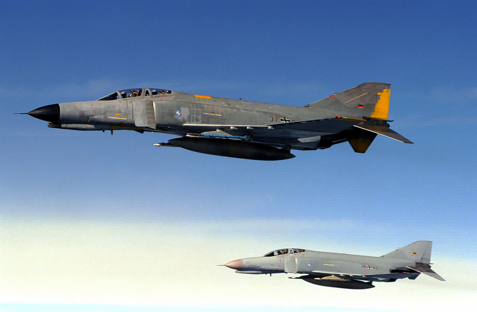 Two German Air Force F-4F Phantom aircraft fly in formation