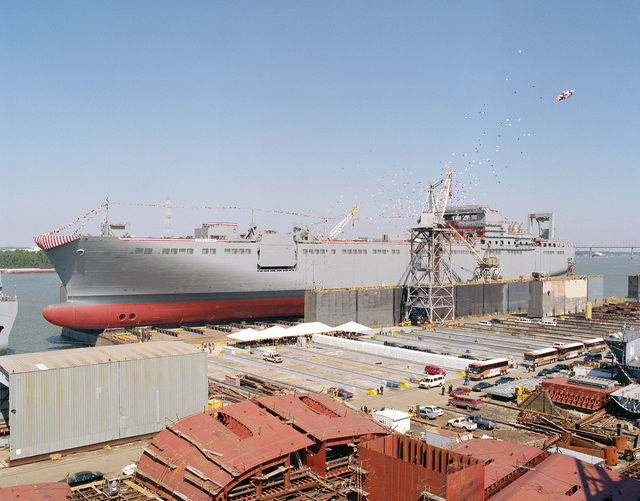 Moments after being christened in ceremonies at the Shipyards Division of Avondale Industries, Inc. the Military Sealift Command (MSC) strategic heavy lift ship USNS FISHER (T-ARK 301) rests in Avondales 80,000 ton floating drydock. The 950 foot long ship is the second of five strategic sealift ships being built for the Navy by Avondale