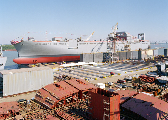 Port bow view of the Military Sealift Command (MSC) strategic heavy lift ship USNS FISHER (T-AKR 301) on the launching platform shortly before christening at the Avondale Industries, Inc. shipyard