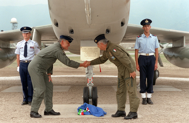 GEN Mario Arpino, CHIEF of STAFF, Italian Air Force and LT GEN Richard C. Betherum, 16th Air Force Commander, shakes hands after the cutting of the ribbon. The plane was dedicated to the 31st Fighter Wing from the Italian Air Force. The F-100 was the USAF's first operational aircraft capable of flying faster than the speed of sound (760 mph) in level flight. Designed originally to destroy enemy aircraft in aerial combat, the F-100 later became a fighter-bomber