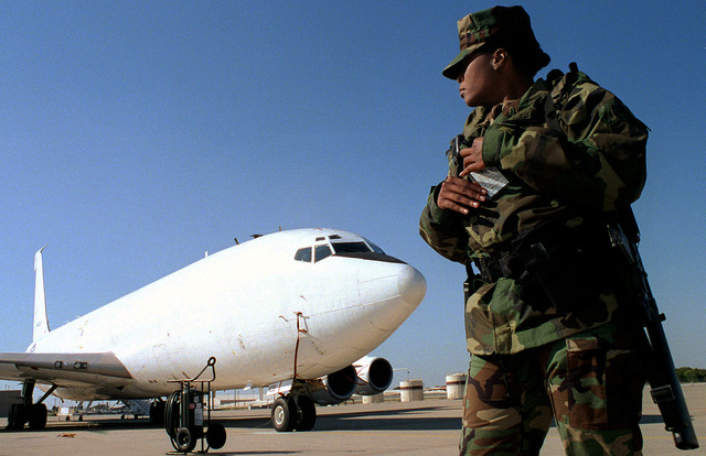 Navy AIRMAN Kimberly Linzy, 72nd Security Forces Squadron, patrols the flight line near an E-6A Mercury aircraft, an airborne communications platform, during the exercise GLOBAL GUARDIAN '98