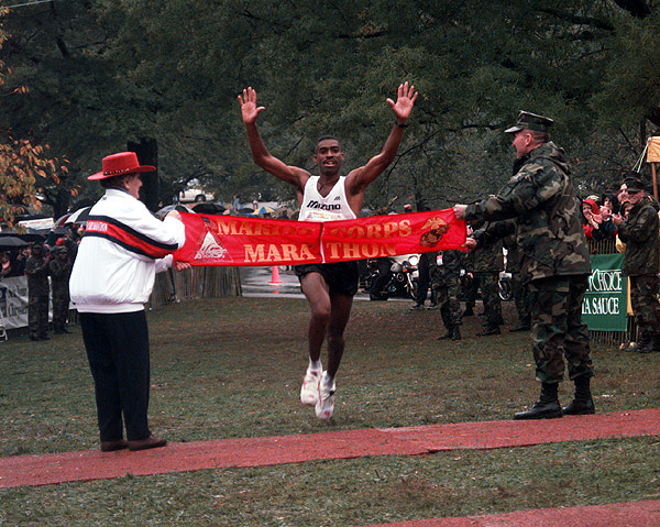 Darrell General (civilian), winner of the men's category for the 22nd Marine Corps Marathon, crosses the finish line at 2:18.20