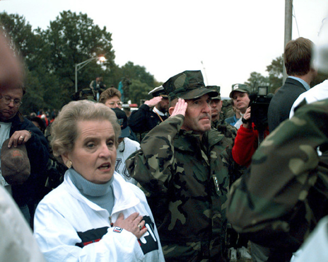 Secretary of State, Madeleine Albright, and the Assistant Commandant of the Marine Corps, GEN. Neil, pay respect to our country during the playing of the National Anthem at the 22nd Marine Corps Marathon