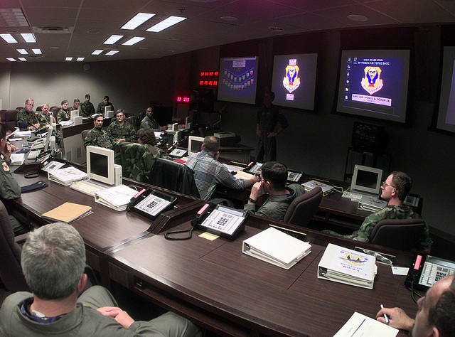 Key personnel of the 509th Bomb Wing meet in the base command post where all operational aspects of the wing's ability to successfully complete the exercise mission are presented. Global Guardian is designed to exercise the ability of USSTRATCOM and its component forces to effectively deter a military attack against the United States and employ forces as directed by the National Command Authority