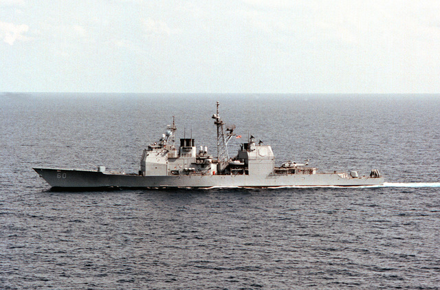 The aegis class cruiser USS NORMANDY (CG 60) underway in the eastern Mediterranean sea. Normandy is part of the aircraft carrier USS GEORGE WASHINGTON (CVN 73) Battle Group, and has received orders from the President of the United States to proceed with the USS GEORGE WASHINGTON (CVN 73) to the Persian Gulf region following the Iraqis repeated violations of UN resolutions imposed following the 1991 Gulf war. Normandy is armed with vertically launched Tomahawk cruise missiles