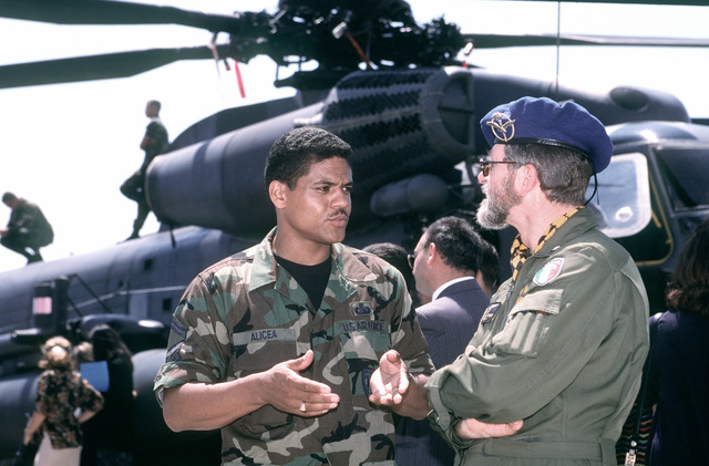 Air Force translator SENIOR MASTER SGT. Eddie Alicea talks to Italian LT. Antonio Tursi during a small open house at San Vito Air Station. San Vito AS, which was officially closed in October 1994, is used to support troops deployed to Bosnia-Herzegovina and aircrews monitoring a no-fly zone above that volatile country. The 352nd Special Operations Group, RAF Mildenhall, England and the 16th Special Operations Wing, Hurlburt Field, Fla. comprise most of the joint task force. Exact Date Shot Unknown . Published in AIRMAN Magazine November 1997