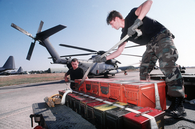 AIRMAN 1ST Class Caleb Ware (right) and AIRMAN 1ST Class Bradley Miller both with the 31st Expeditionary Air Base Squadron unload munitions at San Vito Air Station. San Vito AS, which was officially closed in October 1994, is used to support troops deployed to Bosnia-Herzegovina and aircrews monitoring a no-fly zone above that volatile country. The 352nd Special Operations Group, RAF Mildenhall, England and the 16th Special Operations Wing, Hurlburt Field, Fla. comprise most of the joint task force. Exact Date Shot Unknown . Published in AIRMAN Magazine November 1997