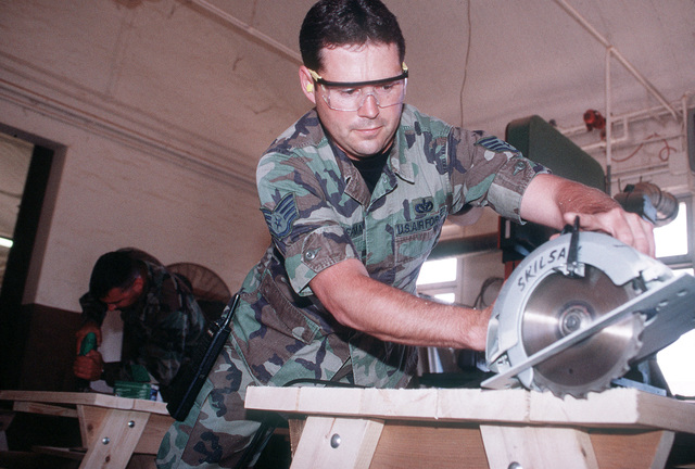 Civil Engineer, STAFF SGT. Todd Hoffman assigned to the 31st Expeditionary Air Base Squadron works overtime to maintain a Skilsaw. San Vito AS, which was officially closed in October 1994, is used to support troops deployed to Bosnia-Herzegovina and aircrews monitoring a no-fly zone above that volatile country. The 352nd Special Operations Group, RAF Mildenhall, England and the 16th Special Operations Wing, Hurlburt Field, Fla. comprise most of the joint task force. Exact Date Shot Unknown . Published in AIRMAN Magazine November 1997