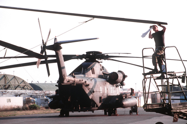 STAFF SGT. Thomas Stark inspects propeller blades on an MH-53 Pave Low at San Vito Air Station. San Vito AS, which was officially closed in October 1994, is used to support troops deployed to Bosnia-Herzegovina and aircrews monitoring a no-fly zone above that volatile country. The 352nd Special Operations Group, RAF Mildenhall, England and the 16th Special Operations Wing, Hurlburt Field, Fla. comprise most of the joint task force. Exact Date Shot Unknown . Published in AIRMAN Magazine November 1997
