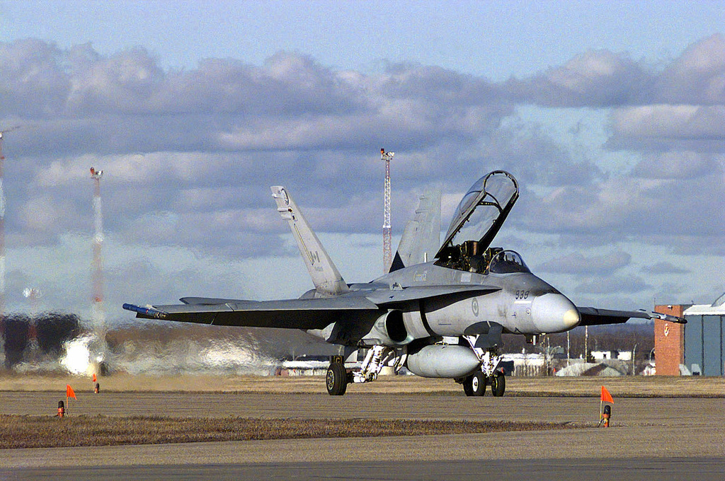 A Canadian Forces' CF-18B Hornet fighter taxis out for take-off from 4 Wing Cold Lake. The 410 Fighter Squadron aircraft are playing the aggressors in the air defense exercise that will test the response of the air intercept and air defense capabilities of the American and Canadian Forces, supporting the mission of NORAD (North American Air Defense command)