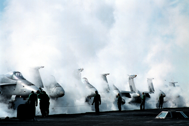 A catapult team performs a first run no-load on the number two catapult steam system during morning preparations for launch aboard USS GEORGE WASHINGTON (CVN 73). George Washington and embarked Carrier Air Wing One (CVW-1) are in the the Persian Gulf to support UN efforts to compel Iraqi compliance with UN resolutions