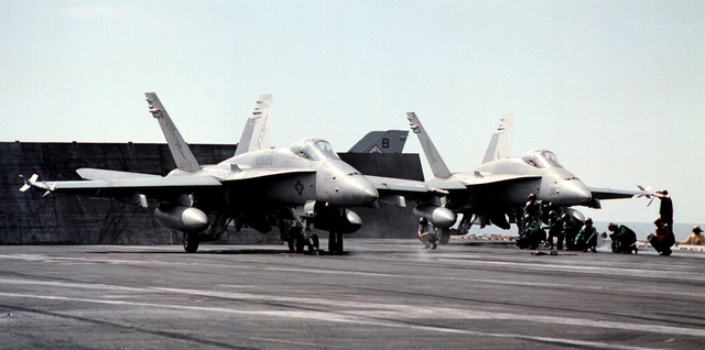 F/A-18C Hornets from Fighter Attack Squadron Two Five One (VMFA-251), assigned to Carrier Air Wing One (CVW-1), make final preparations for launch during normal flight operations. George Washington and Carrier Air Wing One (CVW-1) are in the Persian Gulf to support UN efforts to compel Iraqi compliance with UN resolutions