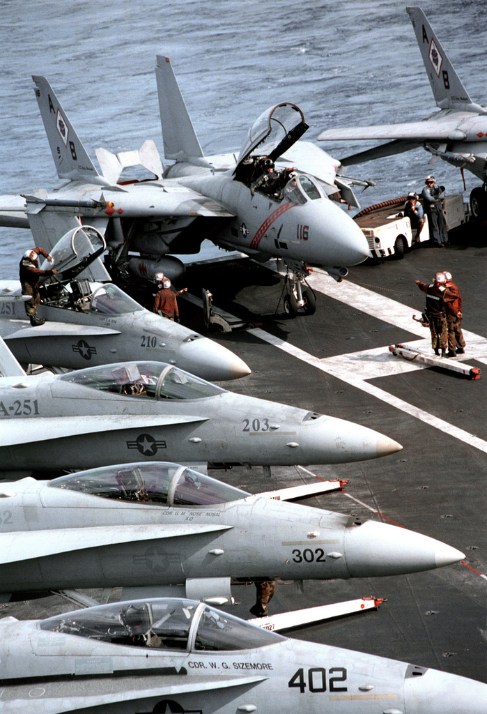 Members of Fighter Squadron One Zero Two (VF-102) conduct pre-launch checks in their F-14B Tomcat fighter intercept aboard USS GEORGE WASHINGTON (CVN 73). George Washington and Carrier Air Wing One (CVW-1) are in the Persian Gulf to support UN efforts to compel Iraqi compliance with UN resolutions