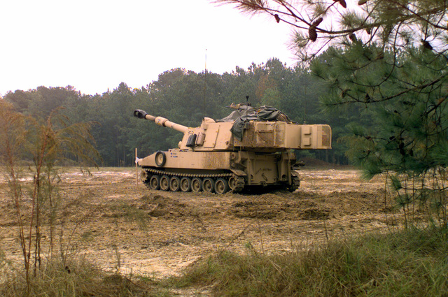 A M109A6 Paladin 155mm self-propelled howitzer stands on the firing range