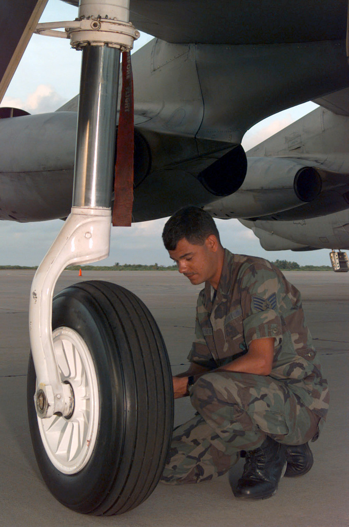 Crew CHIEF SENIOR AIRMAN John Archer, 20th Bomb Squadron, Barksdale Air Force Base, Louisiana, performs daily tire pressure checks on B-52 Stratofortress' from the 96th Bomb Squadron, Barksdale Air Force Base, Louisiana, deployed to Navy Support Facility (NFS) Diego Garcia as part of the Second Air Expeditionary Group in support of Operation SOUTHERN WATCH. SOUTHERN WATCH involves patrolling the no-fly zone in southern Iraq