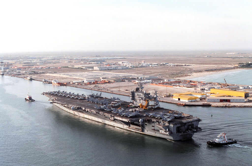 The aircraft carrier USS GEORGE WASHINGTON (CVN 73) pulls into port Jebel Ali, United Arab Emirates. George Washington is conducting operations in the Persian Gulf during a six-month deployment in support of operation Southern Watch