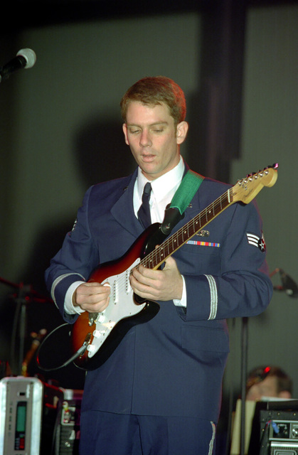 US Air Force (USAF) SENIOR AIRMAN (SRA) Gerald C. Birkenmeier, a member of the US Air Force in Europe (USAFE) Band, performs a guitar solo during an Operation SEASONS GREETINGS '97 concert