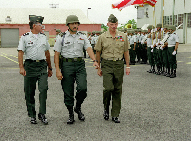 GEN Charles I. Wilhelm, the CINC SOUTHCOM Commander reviews the Puerto Rico Army National Guard (PRARNG) Honor Guard at the Air National Guard airport field. Along with him are left to right: MGEN Emilio Diaz Colon, The Adjutant General, Puerto Rico Army National Guard, and MAJ Sigfredo Perez, the Administrative Officer-Army National Guard and GEN Charles I. Wilhelm, USMC CINC SOUTHCOM