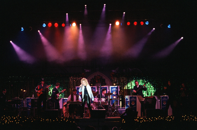 Special guest recording artists Mila Mason performs along with the US Air Force in Europe (USAFE) Band, during an Operation SEASONS GREETINGS '97 concert held at Incirlik Air Base, Turkey