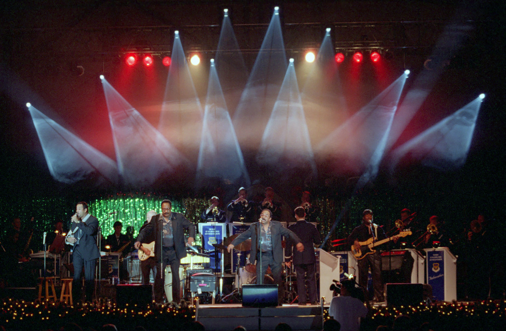 """The Motown recording group """"The Miracles"""" performs along with the US Air Force in Europe (USAFE) Band, during an Operation SEASONS GREETINGS '97 concert held at Incirlik Air Base, Turkey"""