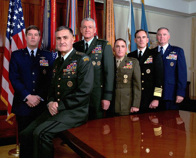 The Joint Chiefs of STAFF (JCS), photographed in their traditional meeting place, the JCS Gold Room at the Pentagon on December 18, 1997. From left to right are: General (GEN) Joseph W. Ralston, US Air Force, Vice Chairman of the Joint Chiefs of STAFF; GEN Henry H. Shelton, US Army, Chairman of the Joint Chiefs of STAFF; GEN Dennis J. Reimer, US Army, CHIEF of STAFF; GEN Charles C. Krulak, US Marine Corps, Commandant; Admiral Jay L. Johnson, US Navy, CHIEF of Naval Operations; GEN Michael E. Ryan, US Air Force CHIEF of STAFF