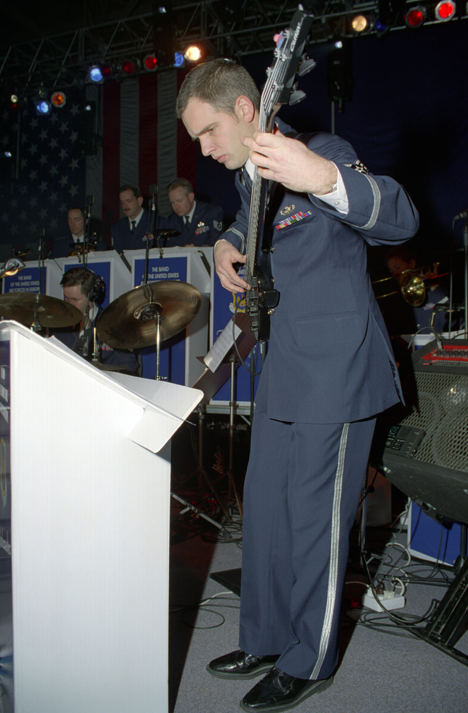 US Air Force (USAF) SENIOR AIRMAN (SRA) Michael E. Smith, plays the bass guitar during a performance with the US Air Force in Europe (USAFE) Band, at the Operation SEASONS GREETINGS '97 concert held at Aviano Air Base, Italy