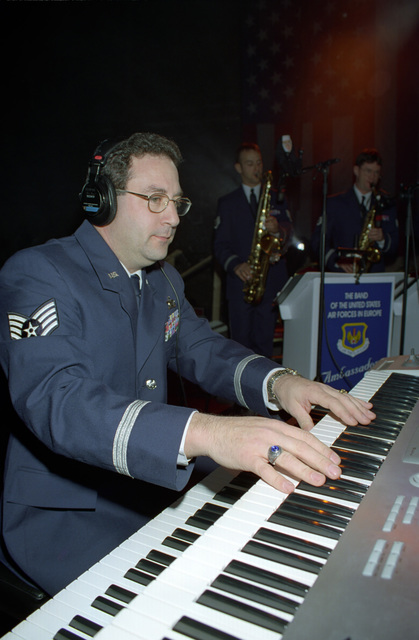 US Air Force (USAF) STAFF Sergeant (SSGT) Paul A. Delgreco, plays the keyboards during a performance with the US Air Force in Europe (USAFE) Band, at the Operation SEASONS GREETINGS '97 concert held at Aviano Air Base, Italy