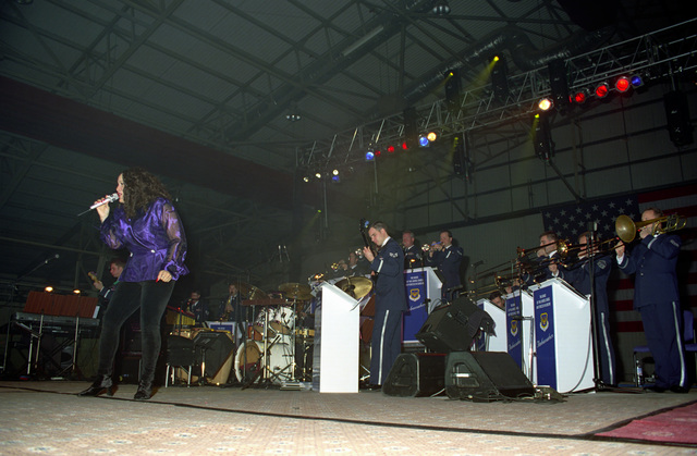 Special guest recording artists Juanita Williams performs along with the US Air Force in Europe (USAFE) Band, during the Operation SEASONS GREETINGS '97 concert held at Royal Air Force (RAF), Lakenheath, United Kingdom (GRB)
