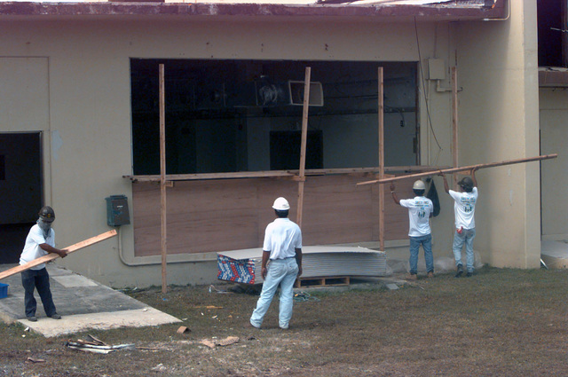 Contractors hired by the Federal Emergency Management Agency enclose what will be a dinning facility. It is part of temporary housing for typhoon victims at Andersen South Air Force Base, Guam, after Super Typhoon Paka