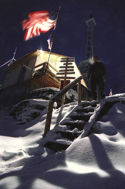 "Military Photographer of the Year Winner 1998 Title: ""By the dawns early light"" Category: Pictorial Place: Honorable Mention PictorialEW2 Dave Kronebusch does an early morning check around the Radio Mir Transmitter site on Grdonj Hill in Sarajevo, Bosnia"