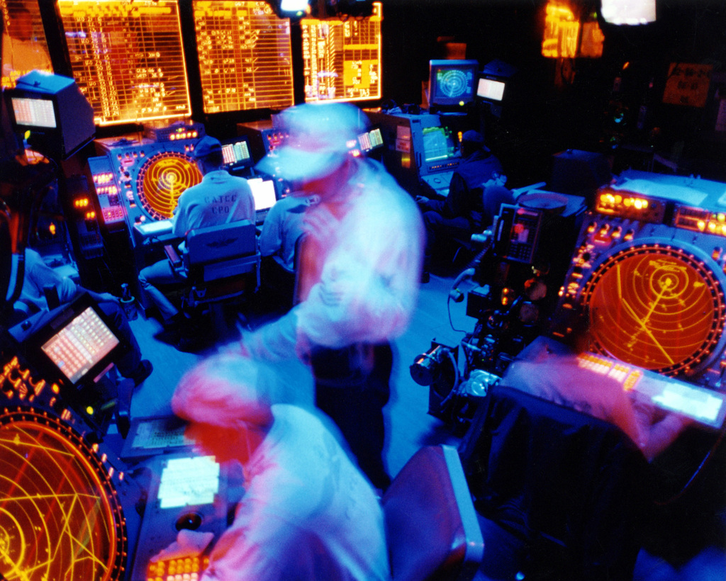 Military Photographer of the Year Winner 1998 Title: Controlling the skies Category: Pictorial Place: Second Place PictorialAir traffic controllers working in the CATCC (Carrier Air Traffic Control Center) assist in guiding aircraft on and off the flightdeck of the USS Enterprise (CVN 65)