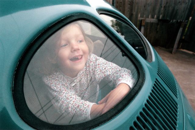 Military Photographer of the Year Winner 1998 Title: Samantha Category: Portrait Place: Third Place PortraitSamantha Dorman, age 4, plays in the back of her father's Volkswagen