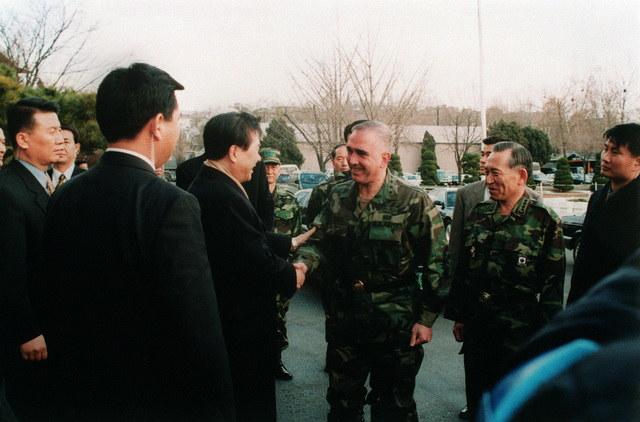 Group photo of South Korean President Kim Young Sam, U.S. Ambassador to Korea, Steven Bosworth, and some members of the Combined Forces Command (CFC) taken in front of the CFC Headquarters