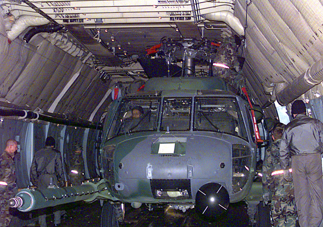 48th Rescue Squadron HH-60 Pave Hawk is loaded into a C-5 Galaxy aircraft to be deployed along with more than 70 people (not shown) to Al Jabar, Kuwait, in support of Operation Southern Watch