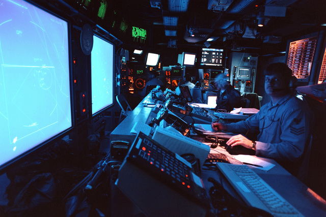 Sonar Technician Charles Jordan monitors the Joint Maritime Command Information System from the combat center of the aircraft carrier USS GEORGE WASHINGTON (CVN 73). George Washington is operating in the Persian Gulf in support of Operation Southern Watch