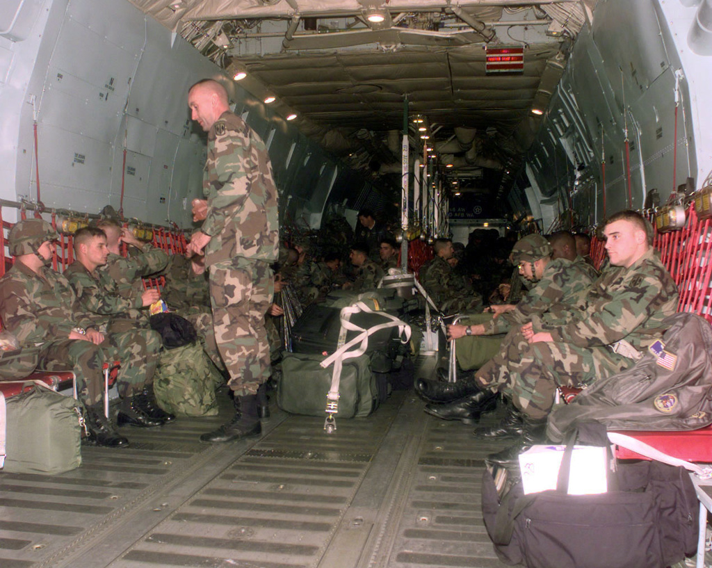 Members of B Company, 1ST Battalion, 377th Field Artillery Regiment (Air Assault) get comfortable in the C-141B Starlifter for their flight to Puerto Rico to take part in JTFX 98-1
