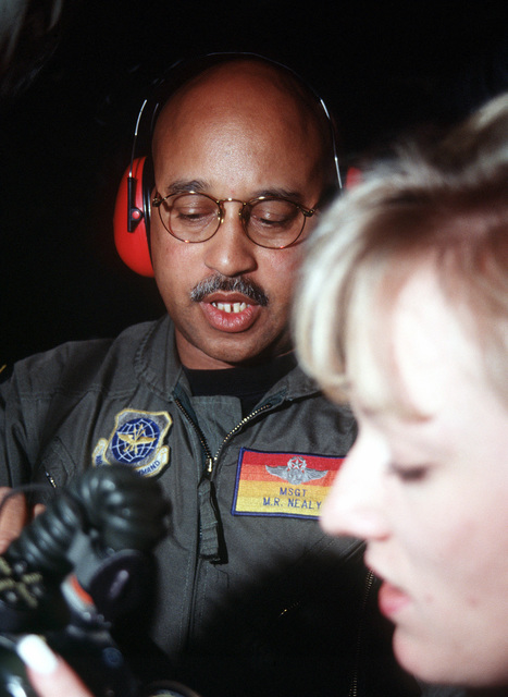 MASTER Sergeant M.R. Nealy (left) and STAFF Sergeant Theresa Wagner, 452nd Aeromedical Evacuation Squadron, March Air Reserve Base, California, conduct in-flight training on the KC-135 Stratotanker aircraft oxygen system