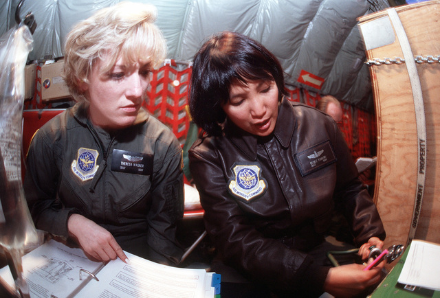 STAFF Sergeant Theresa Wagner and MASTER Sergeant Cecile Tamayo, 452nd Aeromedical Evacuation Squadron, conduct training on the Therapy Oxygen Generator, which is used to provide emergency oxygen to patients in-flight