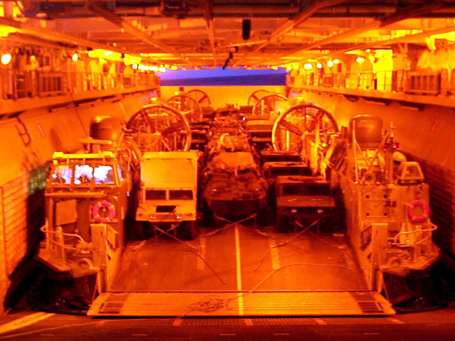 Three Landing Craft Air Cushions (LCACs) attached to Assault Craft Unit 4 (ACU-4) sit aboard the USS WASP (LHD 1) loaded and ready to transport vehicles, equipment and Marines from 26th Marine Expeditionary Unit (MEU) ashore during Joint Task Force Exercise 98-1 (JTFX 98-1)
