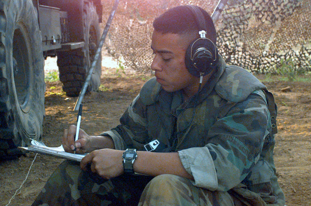 US Marine Corps Lance Corporal David A. Flores, Fire Mission Data Recorder for Gun 6, Kilo Battery, Battalion Landing Team 3/2, records firing data for his M-198 Howitzer gun during Supporting Arms Coordination Exercise, Joint Task Force Exercise 98-1, Vieques Island, Puerto Rico