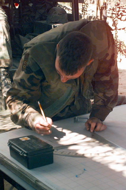 US Marine Corps Lance Corporal Todd J. Cofield, a chart operator with Kilo Battery, Battalion Landing Team 3/2, manually checks the safety box of the impact area from the Fire Direction Center behind Howitzer Gun Position 4 during Supporting Arms Coordination Exercise, Joint Task Force Exercise 1-98, Vieques Island, Puerto Rico