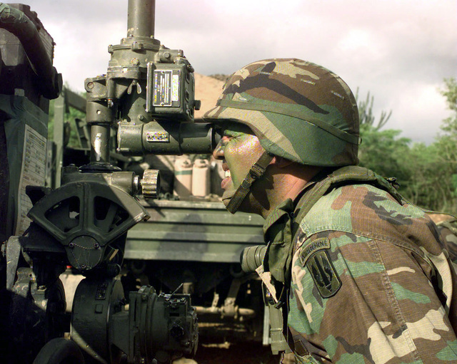 "SSG Gregorio Santoni of B Battery, 1ST Battalion, 377th Field Artillery Regiment (Air Assault), Fort Bragg, North Carolina, checks the ""zero"" coordinates on his section's M-198 155mm howitzer which will be used during JTFX 98-1 with the 26th Marine Expeditionary Unit, Camp Lejeune, North Carolina"