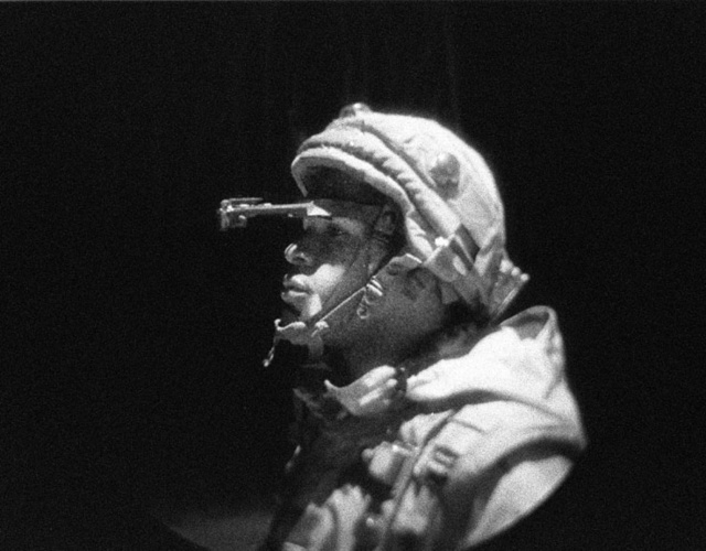 A Marine from CSSE (Combat Service Support Element) uses night vision goggles during a night mobility course performed at the MOUT (Military Operations in Urban Terrain) facility during LOE 1 (Limited Objective Experiment 1). Urban Warrior is the U.S. Marine Corps Warfighting Laboratory's series of limited objective experiments examining new urban tactics and experimental technologies