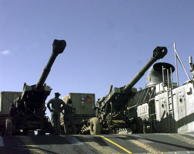 Members of the Beachmaster Unit Two, Naval Amphibious Base (NAB) Little Creek, Norfolk, Virginia, inspect the M-198 155mm howitzers loaded onto a landing craft air cushion (LCAC) vessel during the extraction of soldiers of B Battery, 1ST Battalion, 377th Field Artillery Regiment (Air Assault), Fort Bragg, North Carolina after participating in JTFX 98-1